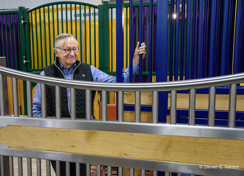 Robert Mooney of Equine Design Partners poses with horse stalls he sells at Equine Affaire on Friday. (Steven E. Nanton photo)