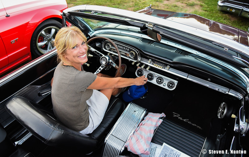 Renee White, of Ludlow, sits behind the wheel of her 1963 Ford Falcon Sprint at Ludlow Elks Lodge 2448's Cruise Night on Tuesday. (Steven E. Nanton photo)