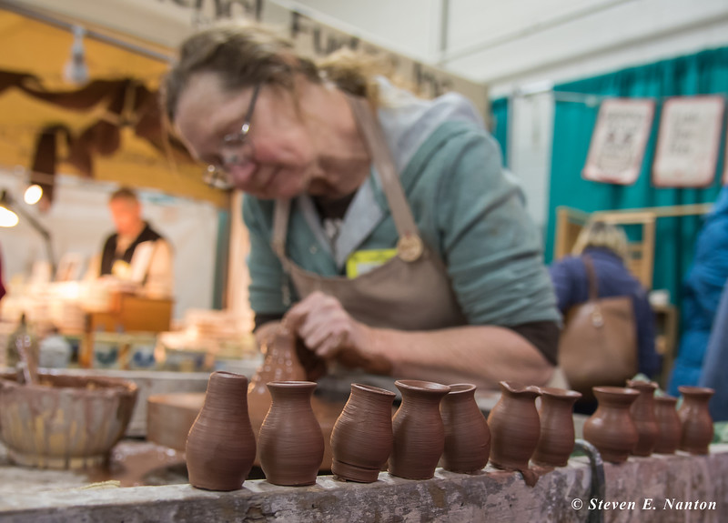 Regina Delarm of East Knoll Pottery makes some mini pottery at the Old Deerfield Spring Sampler Craft Fair at the Big E in West Springfield on Saturday. (Steven E. Nanton photo)