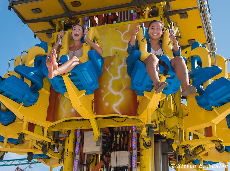 Gabi Levine, left, and Marie Chin, both seniors at the University of Massachusetts, Amherst, ascend on the Mega Drop ride on Salute to Chicopee Day at the Big E. (Steven E. Nanton photo)