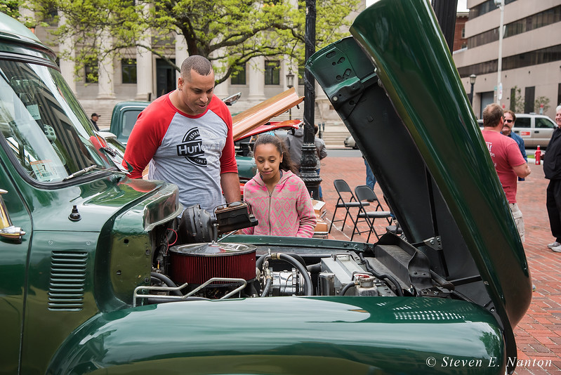Jose Marchi and his daughter, Angelina Marchi, both of Chicopee, look over a 1954 Ford Panel Delivery truck at Springfield Business Improvement District's weekly Monday night Cruise Night at Court Square. (Steven E. Nanton photo)