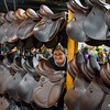 Jennifer Wintersteen of Antares French Used Saddles peers through a display of saddles in the Better Living Center at Eastern States Exposition in West Springfield during  Equine Affaire on Friday. (Steven E. Nanton photo)