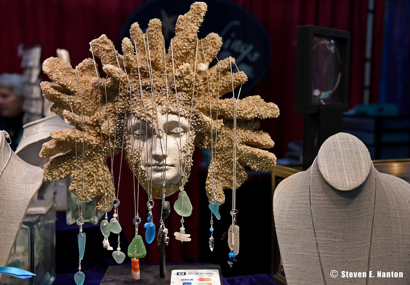 A Medusa head serves to display jewelry from Beachcomings Studio at the 29th annual Old Deerfield Holiday Sampler Craft Fair at the Eastern States Exposition in West Springfield on Saturday. The fair continues on Sunday. (Steven E. Nanton photo)