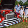 Dad Josh and his twins, Ellie and Emrich, both 8, of Brimfield, check out a 1950s-era Chevrolet at  Brimfield Winery and Cidery's Classic Cruisin' on Friday evening.