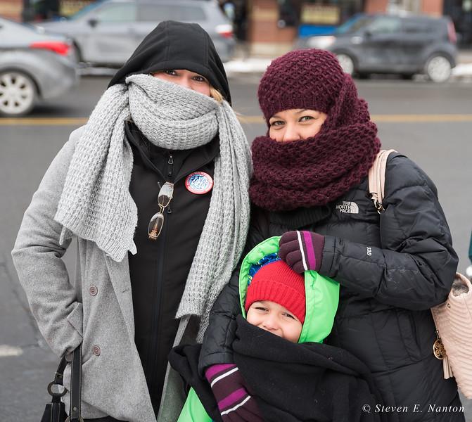 Bundled up against the cold while waiting to get into the Academy of Music in Northampton are Ivehsse Mendoza, left, Majorie Mathias, right, and Sebastian Cruz, all of Puerto Rico. They were taking part in the 33rd annual First Night festivities on New Year's Eve. (Steven E. Nanton photo)