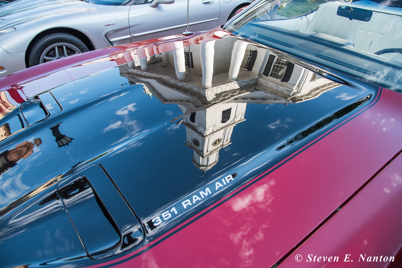 Old First Church is reflected in the hood of a 1973 Ford Mustang 351 Ram Air owned by Ken Turowsky, of East Longmeadow, at Springfield Business Improvement District's Cruise Night on Monday at Court Square. (Steven E. Nanton photo)