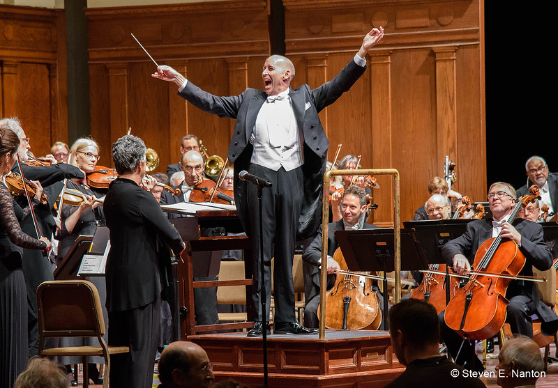 Maestro Kevin Rhodes conducts the orchestra in performing the  National Anthem at Opening Night of the Springfield Symphony 75th Anniversary Season at Symphony Hall on Saturday night.  (Steven E. Nanton photo)