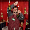 Kyle Gallwaway, of Inspiration & Creation Studio in Somers, hangs ornaments at the 29th annual Old Deerfield Holiday Sampler Craft Fair at the Eastern States Exposition in West Springfield on Saturday. The fair continues on Sunday. (Steven E. Nanton photo)