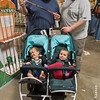 James Strempfer Jr., left, of Windsor, Connecticut, shows a fishing rod to his friend, Mike Allen, of Windsor Locks, as Strempfer's twins, Oliver, left, and Adeline, 18 months, amuse themselves at the 2017 Springfield Sportsmen's Show at the Big E in West Springfield on Friday. (Steven E. Nanton photo)