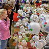 Kim Clarke and her daughter, Ebony, 7, of Springfield, Vermont, look over ornaments at Little Painted Creations at the 29th annual Old Deerfield Holiday Sampler Craft Fair at the Eastern States Exposition in West Springfield on Saturday. The fair continues on Sunday. (Steven E. Nanton photo)