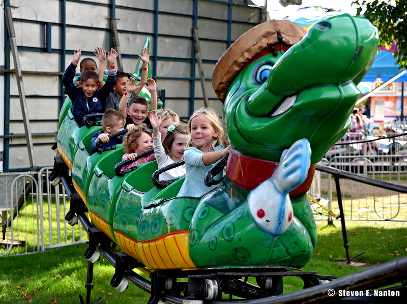 A group of children enjoy themselves on a crocodile coaster on Springfield Day at The Big E in West Springfield on Monday. (Steven E. Nanton photo)