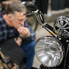 John Highter, of Brattleboro, Vermont, looks over a 1940 Indian Motocycle at the 13th annual Springfield Motorcycle Show at Eastern States Exposition in Springfield on Saturday. (Steven E. Nanton photo)