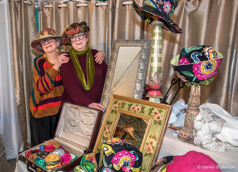 Marcia, left, and Carla Press pose at their Meshugenah Hat Co. stand at the Old Deerfield Spring Sampler Craft Fair at Eastern States Exposition in West Springfield on Saturday. (Steven E. Nanton photo)