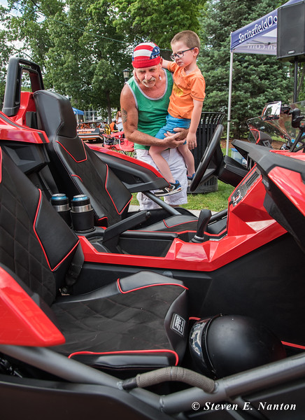 Patrick Sullivan and his son, Johnny Sullivan, 5, both of Springfield, check out a 2015 Polaris Slingshot owned by Ray Lalli, of East Longmeadow, at Springfield Business Improvement District's Cruise Night on Monday at Court Square. (Steven E. Nanton photo)
