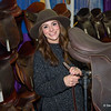 Ricki Corrieri of Equitack adjusts a saddle on display at Equine Affaire on Friday. (Steven E. Nanton photo)