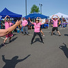 The Gloria's Warriors team performs jumping jacks to warm up for their race at the seventh annual Springfield Dragon Boat Festival on the Connecticut River on Saturday. (Steven E. Nanton photo)