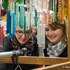 Linda Leahy, left, and Darlene Cortis, both of Westfield, look over wind chimes at Crafty Peddler at the 30th Old Deerfield Holiday Sampler Craft Fair on Saturday at Eastern States Exposition's Better Living Center in West Springfield. (Steven E. Nanton photo)
