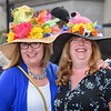 Carrie Temple, left, and Lori Parker, both of Enfield, wear flowered hats at the Horsin' Around Patio Party at MGM Springfield to see the  145th running of the Kentucky Derby on Saturday. (Steven E. Nanton photo)