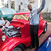 Marcus Norwood, of Springfield, takes a selfie next to the 1934 Ford of Daniel St. Germain at Springfield Business Improvement District's Cruise Night on Monday at Court Square. (Steven E. Nanton photo)