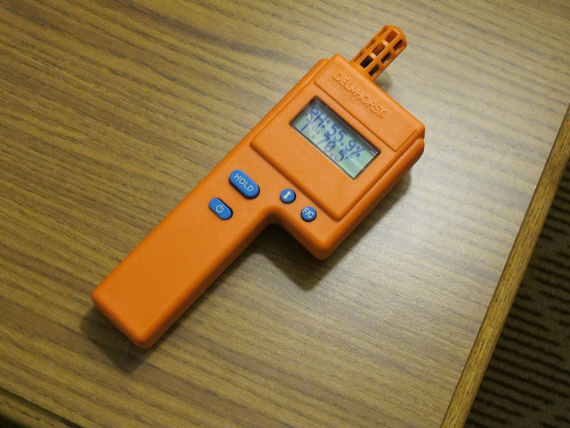 One of our new instruments to help us analyze damaged buildings.  This is a Thermal Hygrometer.  It accurately measures temperature and humidity and calculates dew point and grains of moisture in a pound of air.  Helps us decide what to do to dry out a wet building.