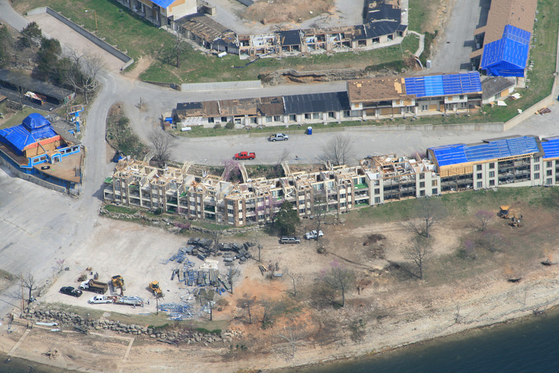 This is building 300 of the resort, with the roof trusses missing.  The clutter in the foreground is salvaged parts from the damage boat docks (another subject of interest)