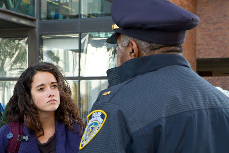 Woman student activist and police officer at Occupy UMass Boston March and Rally. November 11, 2011. Creative Commons BY-NC-SA 2011 Jason Pramas.