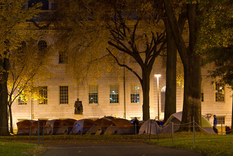 OccupyHarvard encampment on 11/10/11 at 1:15 a.m. Shot from outside Harvard University's Johnston Gate (about 200 ft. away) after the university administration locked down Harvard Yard. Creative Commons BY-NC-SA 2011 Jason Pramas.