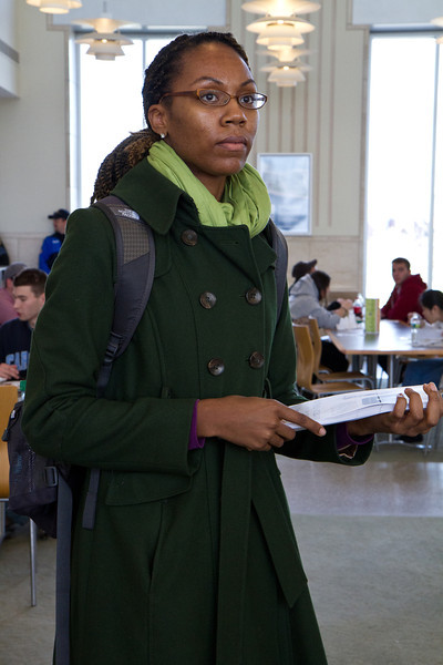 Student activist handing out leaflets in cafeteria at Occupy UMass Boston March and Rally. November 11, 2011. Creative Commons BY-NC-SA 2011 Jason Pramas.