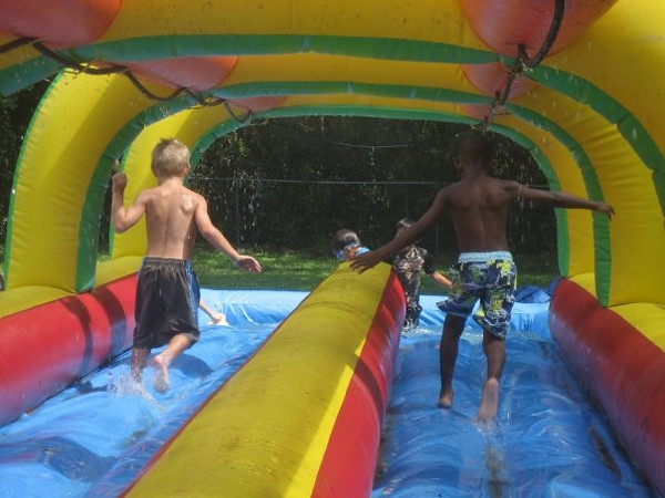 One of the boys' favorite activities, Water Slide!