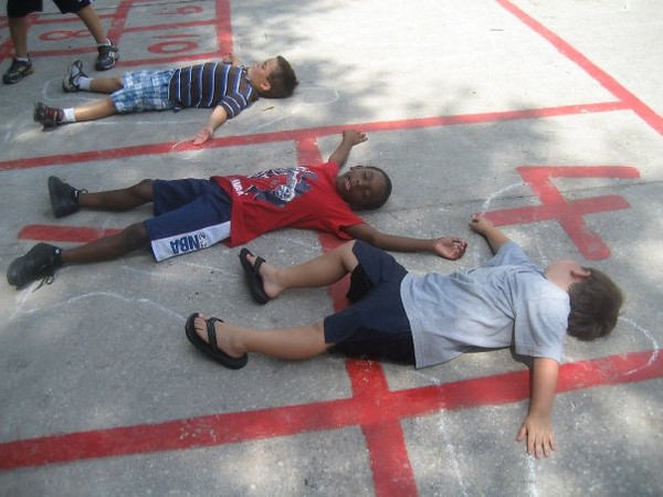 Dylan, Mike, and Donavan, laying in the Chalk outlines.