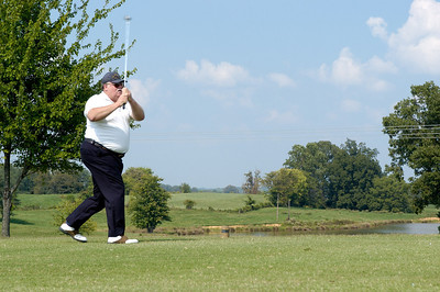 Bruce Farmer shoots a wild shot at the Kentucky EMS Conference and Expo Golf Scramble. The Summit Golf Course.