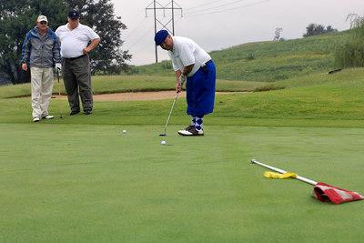 LifeNet's David Williams sinks a put. Kentucky EMS Golf Scramble. Summit County Club, Owensboro.  N37° 48.35' W87° 00.26'