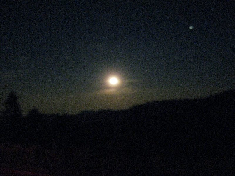 Heading west, moonrise along Sugarloaf Road, CO