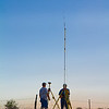 Land surveyors set up in the early morning hours in Orla, Texas.