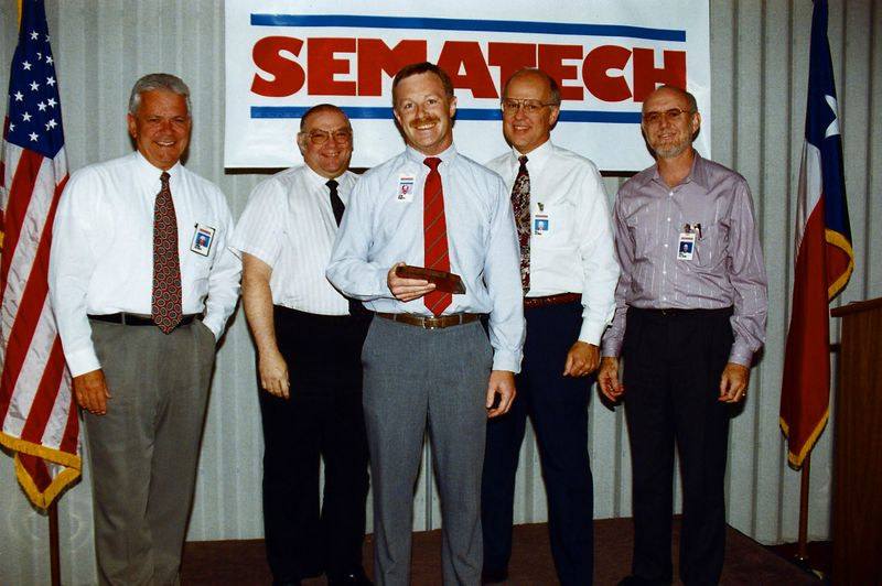 "Sean's exit ""roast"" in 1993.  From left-right:  Frank Squires (CAO), Sam Harrell (CTO), Sean, Bill George (COO), Ansel Goldgar (TI Assignee)."