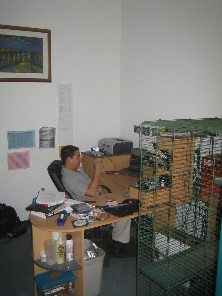 Eric, our Computer and networking specialist, has his office near the server room.  His iguana cage is in the foreground.