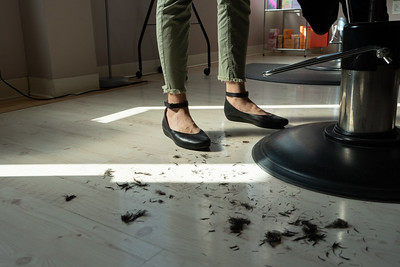 Since the salon's floor is such a light color, even the smallest amount of hair is noticeable, so the entire salon needs to be swept frequently.