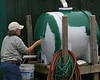 "At the last workday, Diane Nunley suggested to Chester that he paint the cistern black to reduce the slim in the tank. She was surprised to find that Chester was ready with paint for her at this workday—even though it was green. Be sure to <a href=""http://sundownisland.smugmug.com/gallery/4543389_TSEf8#267618229"">view Diane's photos of the birds too!</a> <br><em>Photo credit: Marcy Spears</em>"