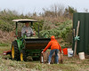 Jeremy King helps his Dad (Jackie King) by placing barrels to be smashed in front of the tractor. <br><em>Photo credit: Marcy Spears</em>