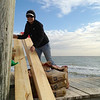 <div align=left>Victoria Fluitt helps unload the lumber for the dock.  You would not believe how much heavy stuff Victoria can move! <em>Photo credit: Peggy Wilkinson</em></div>