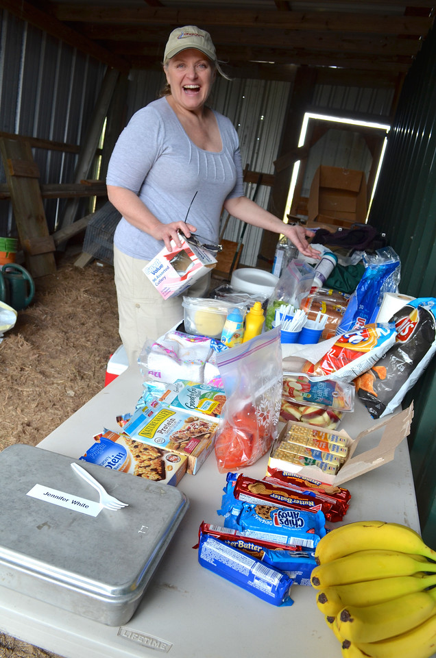 Dee Williams puts out the picnic spread inside the shed.<br /> <br /> (Photo: Peggy Wilkinson)