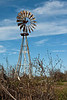 For most volunteers the windmill has become a favorite landmark on the island. It is not working well but Ducks Unlimited has provided a grant to bring it get it back in good-working condition.<br><em>Photo credit:  Diane Nunley</em>