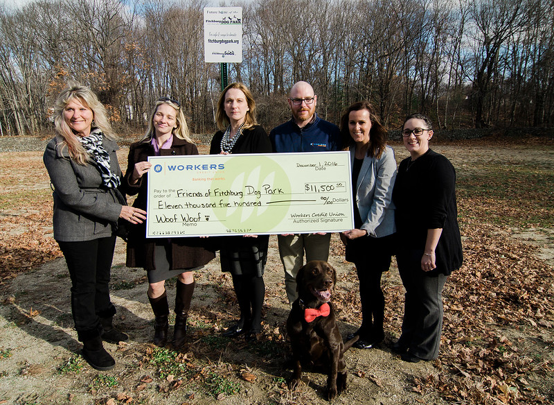 Worker's Credit Union has donated $11,500 to the Fitchburg Dog Park Fund. From left is Brenda Watson, VP of the dog park, Sam Squailia, president, Sandra Sagehorn-Elliott, COO of Worker's Credit Union, and Worker's employees Josh Williams, Alysa Duval and Bianca Law. SENTINEL & ENTERPRISE / Ashley Green