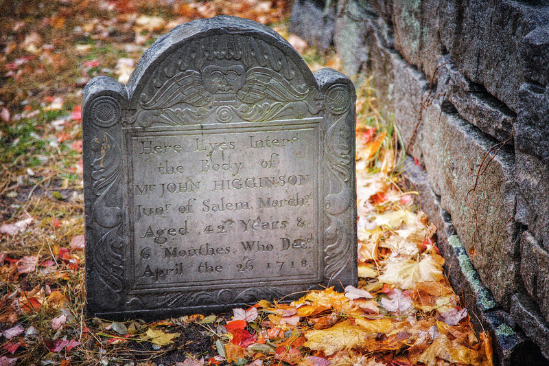 Colonial Era Tombstones: Gravestone With Winged Soul Effigy of Mr. John Higginson of Salem. Old Burial Ground, Salem, Essex County, Massachusetts