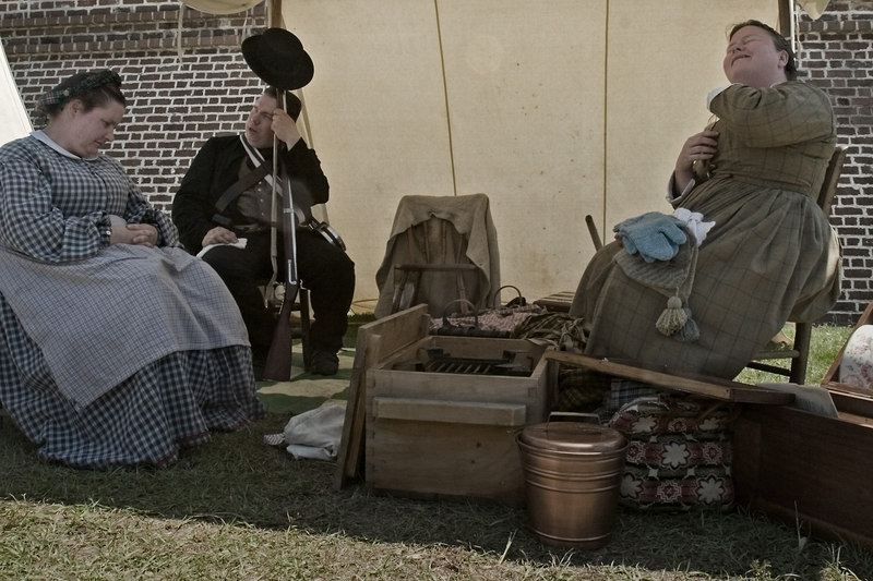 "Outside Fort Moultrie, in the days before the ""Civil"" war.  A peaceful reinactment.<br /> 4/23/2006<br /> Southerners, in case there would be a question of which side these people would have been on.  They worked they waited.  Men came to enlist....<br /> These people are not acting, they are getting ready to leave.  The woman is hot and wiping herself with a handkerchief.  The couple are probably making plans for the ""drive"" home.  Kind of surreal, a trip in Time.  Lives lived in the present enacting the past."