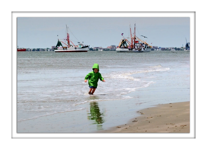 Blessings: Boy plays while shrimp boats wait their turn.