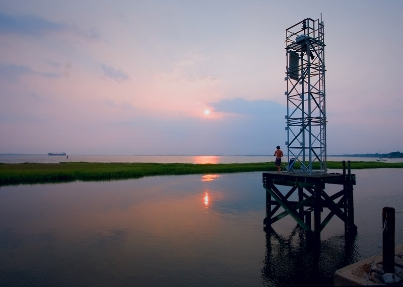 After The Storm: boys fishing off a signal light stand overlooking the Charleston Harbor.<br /> 7/26/2006
