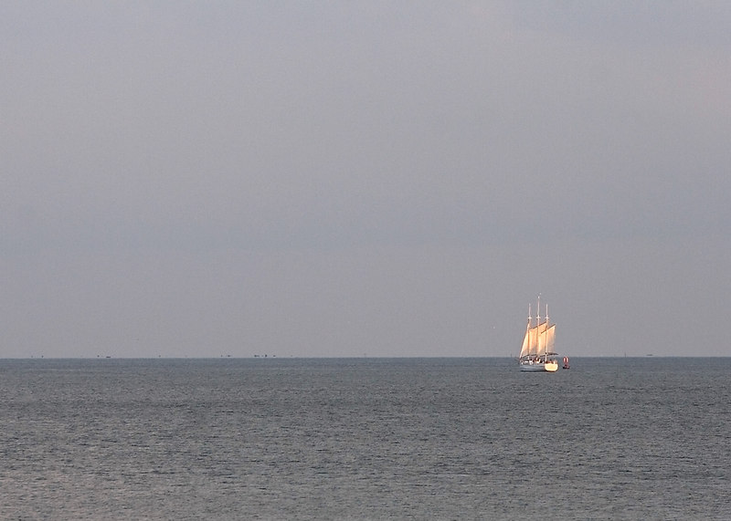The sailboat broke free and sails in the light.......