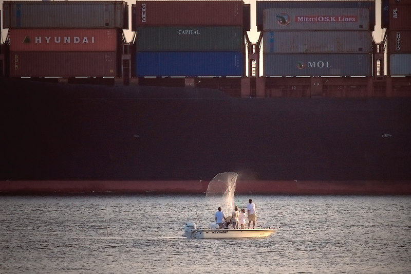 Shrimp Baiting Season Begins, with a salute of a net to a passing freighter in the Charleston Harbor.<br /> <br /> 9/15/2006