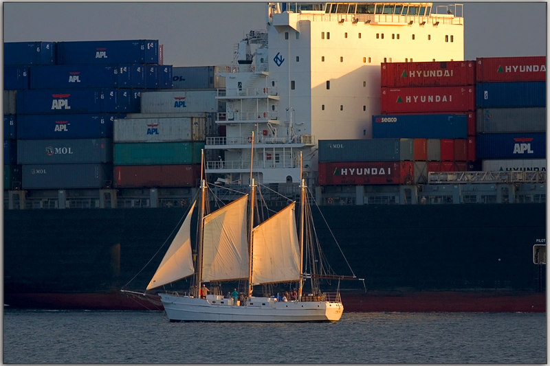 The container ships go out on the tide........the sail boats, they ride with the sun.
